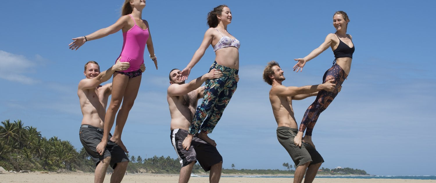 acro yoga at the beach in front of the hotel