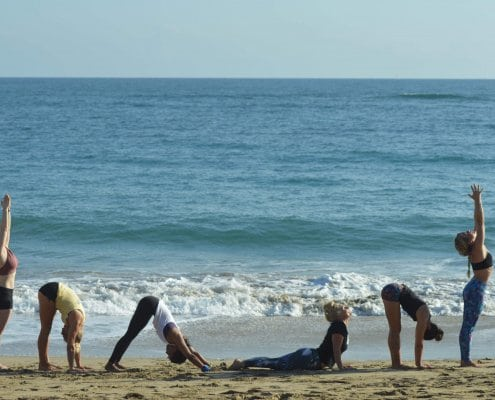 sun salutations at the beach yoga Cabarete